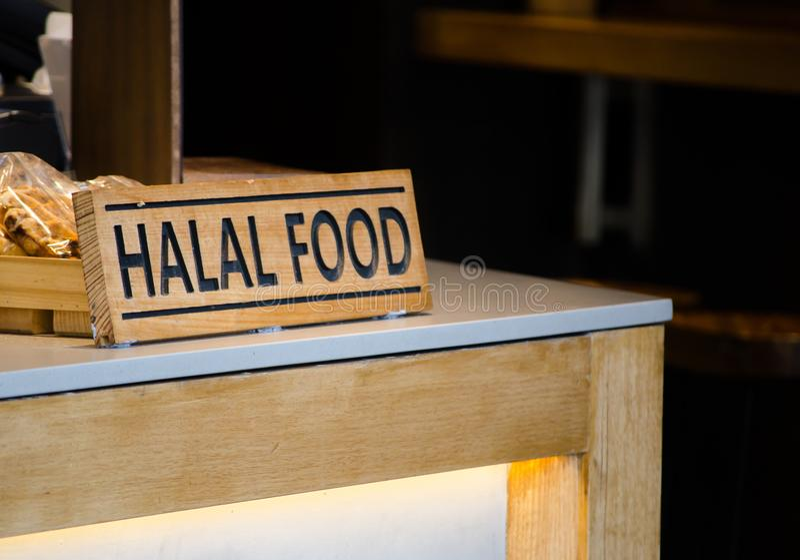 Timber Halal food sign at a restaurant counter. stock image