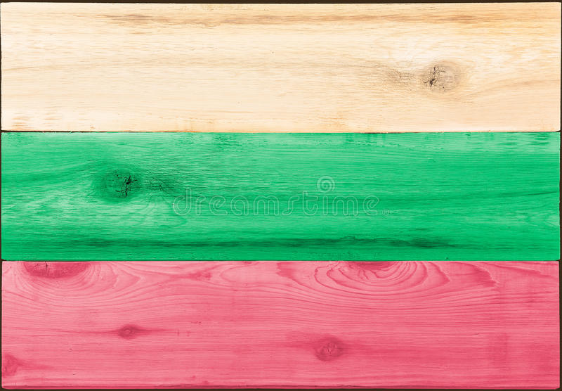 Timber planks in the shape of a Bulgaria flag. Timber planks of wood that have been painted or stained in the colors of a Bulgarian flag as a background stock images