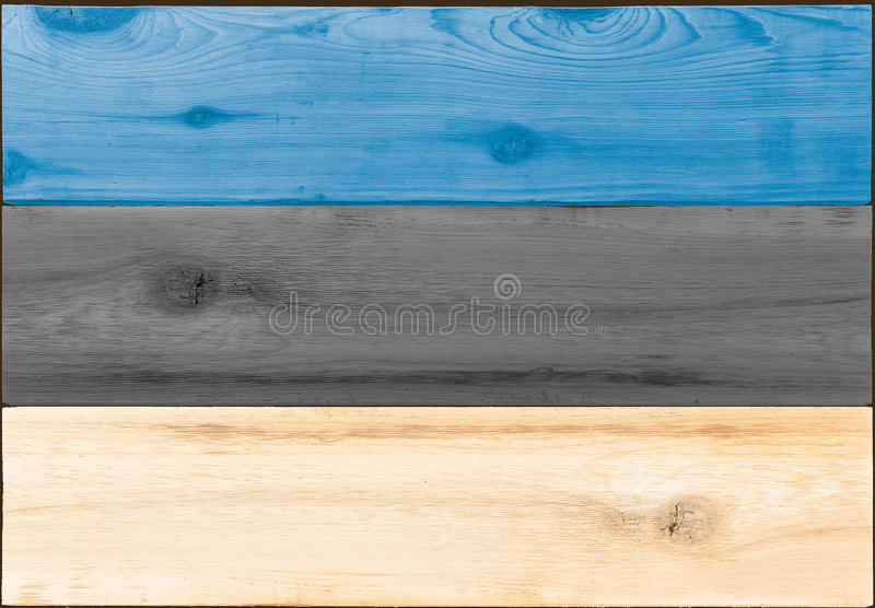 Timber planks in the shape of an Estonia flag. Timber planks of wood that have been painted or stained in the colors of an Estonian flag as a background royalty free stock photo
