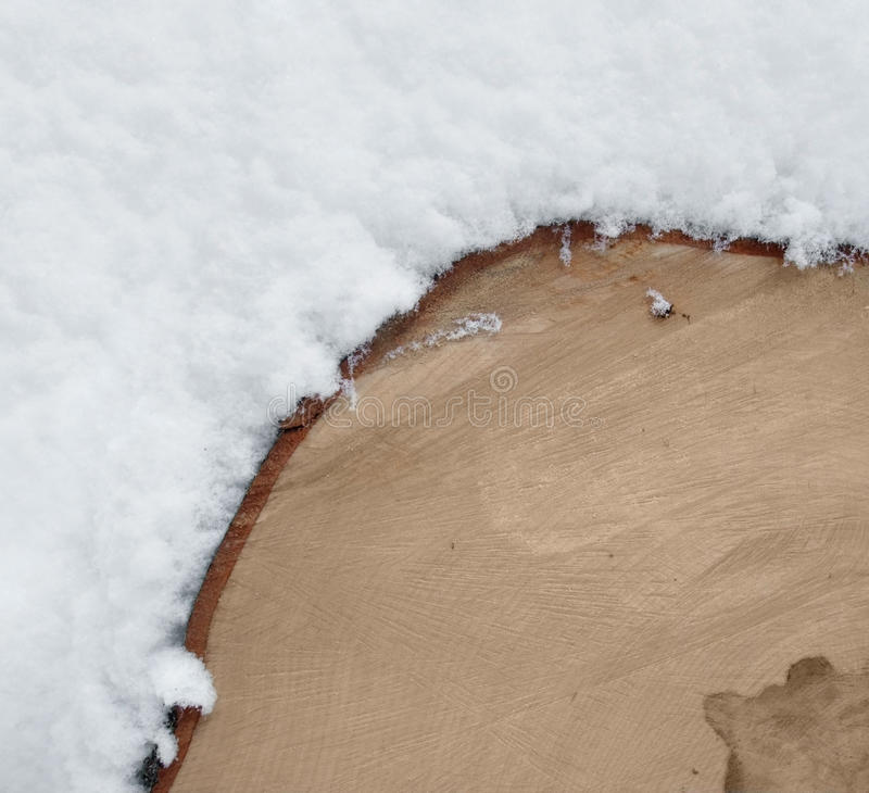 Timber and snow. Full frame abstract background with timber and snow stock photos