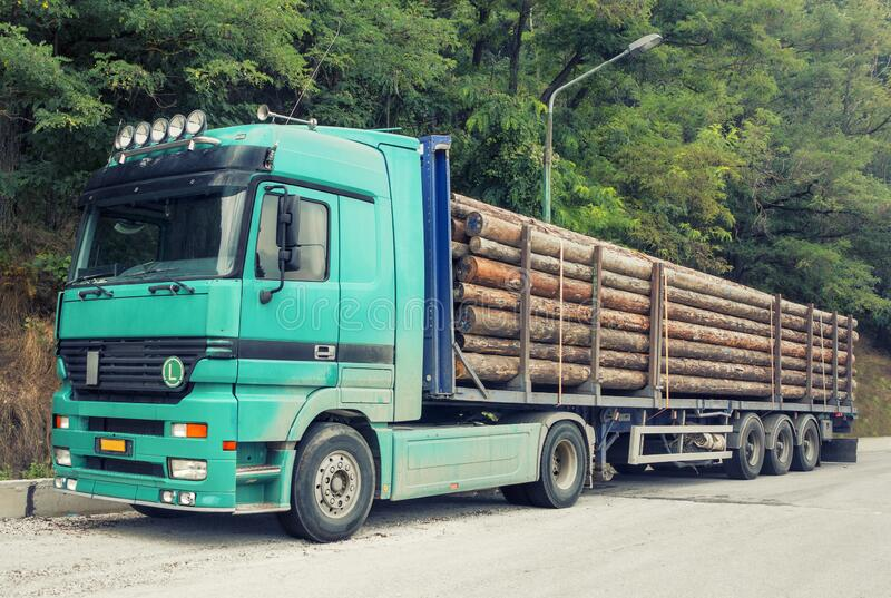 Timber truck on a road stock photos
