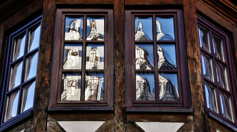 Timbered house with bay windows. Close up of timbered house with bay windows stock photography