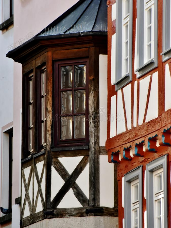 Timbered house with bay windows. Close up of timbered house with bay windows royalty free stock images