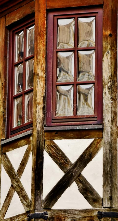 Timbered house with bay windows. Close up of timbered house with bay windows royalty free stock photos