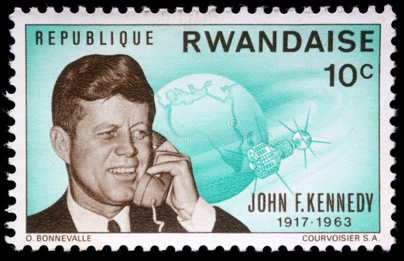 Timbre imprimé par le Rwanda, expositions John Fitzgerald Kennedy images stock