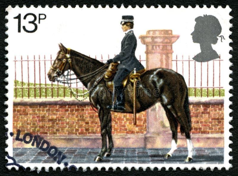 Timbre-poste BRITANNIQUE monté de police images stock