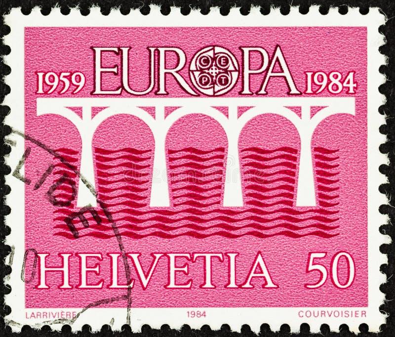 Timbre rose de l'Europa 1984 de la Suisse photographie stock