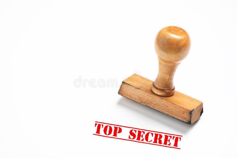Timbro di gomma con il segno top-secret su fondo bianco fotografia stock libera da diritti
