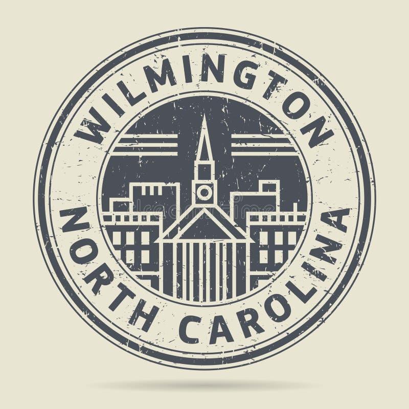 Timbro di gomma o etichetta di lerciume con testo Wilmington, Carolin del nord illustrazione vettoriale