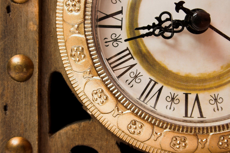 The time. Old wooden clock showing time, close-up stock photo