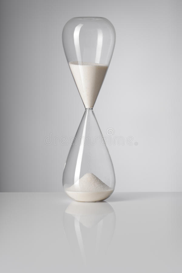Time. A Hourglass on reflective background royalty free stock image