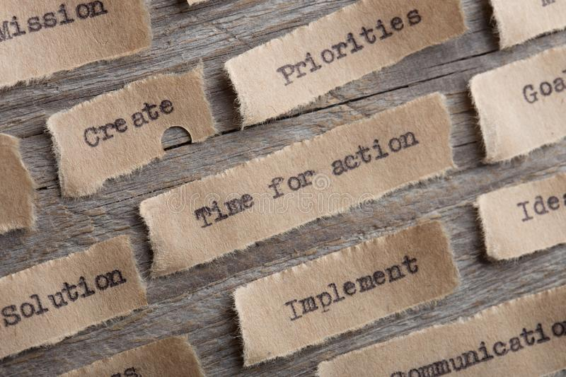 time for action word on a piece of paper close up, business creative motivation concept stock photos