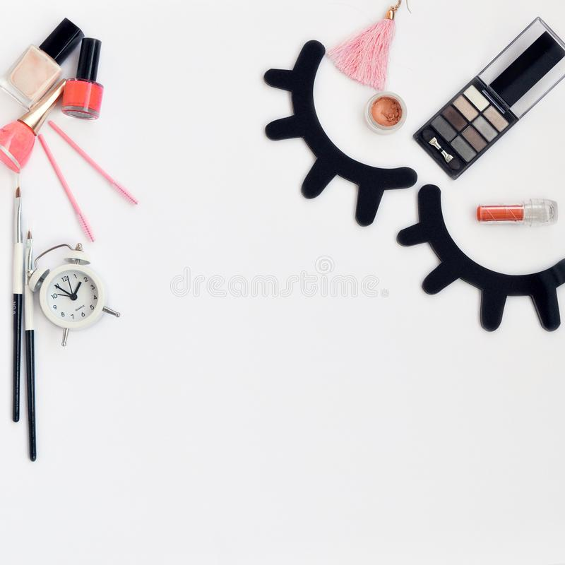 Time for beauty eyelashes and eyebrows: eyelash extension tools and decor on white background with copy space. top view. Flatley. Time for beauty eyelashes and stock photography