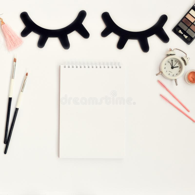 Time for beauty eyelashes and eyebrows: eyelash extension tools and decor on white background with copy space. top view. Flatley. Time for beauty eyelashes and stock photo