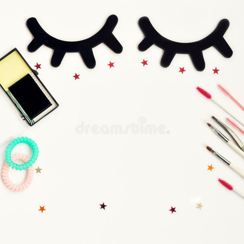 Time for beauty eyelashes and eyebrows: eyelash extension tools and decor on white background with copy space. top view. Flatley. Time for beauty eyelashes and stock image