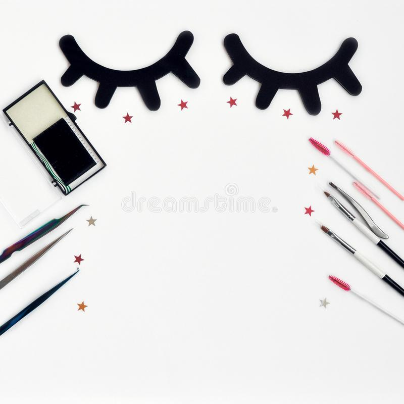Time for beauty eyelashes and eyebrows: eyelash extension tools and decor on white background with copy space. top view. Flatley. Time for beauty eyelashes and royalty free stock photography