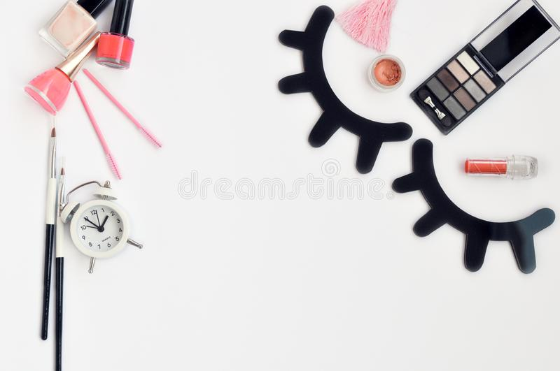 Time for beauty eyelashes and eyebrows: eyelash extension tools and decor on white background with copy space. top view. Flatley. Time for beauty eyelashes and royalty free stock image