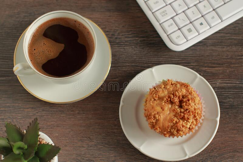 Time for a break with coffee and muffin on a desk stock photos