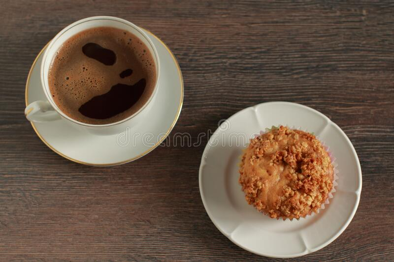 Time for a break with coffee and muffin on a desk stock photography