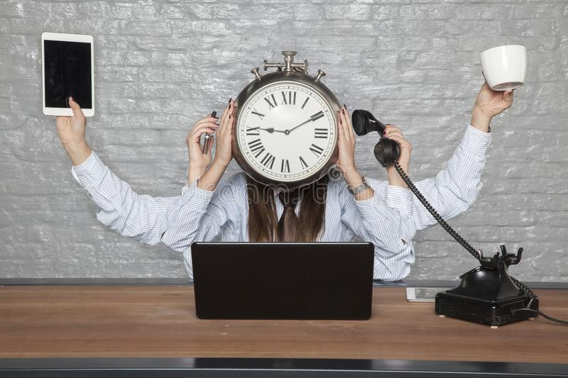 Time is business, multitasking business woman stock photography