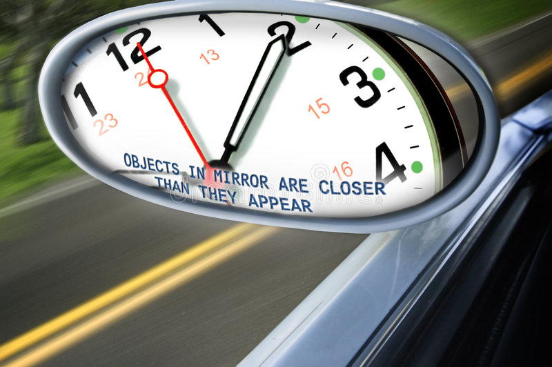 Time is catching up. A clock face is reflected in the side mirror of a speeding vehicle. Suggests you have less time than you think time is closing in on you