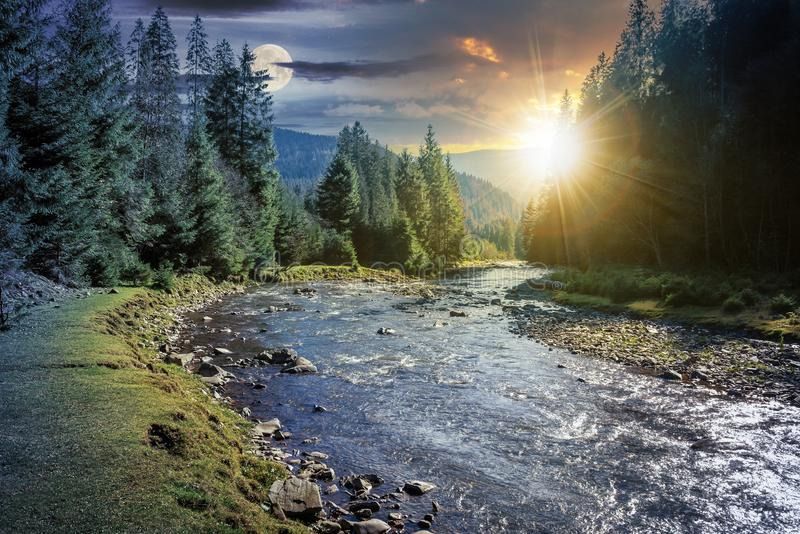 Time change above mountain river in forest stock images