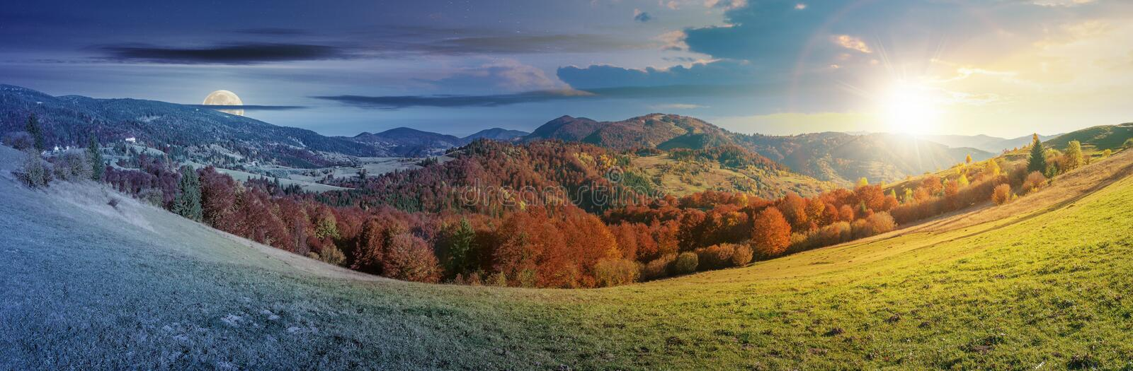 Time change above panoramic landscape in october. Day and night time change concept above panoramic landscape in october. grassy meadow and trees in fall foliage royalty free stock photo