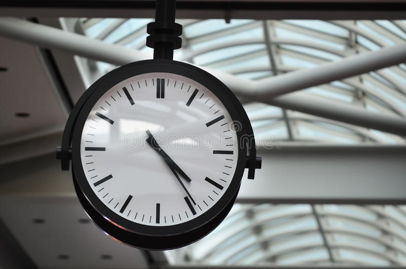 Time Classic Analog Clock. A classic black and white analog clock stock photography