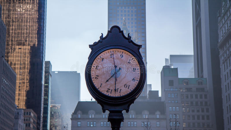 Time. A clock in New York whose digits are upside down stock image