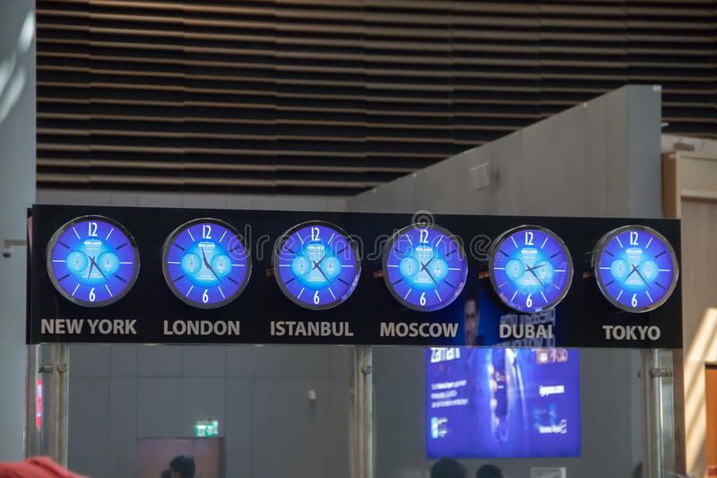 Time clocks with time zones at airport stock photography