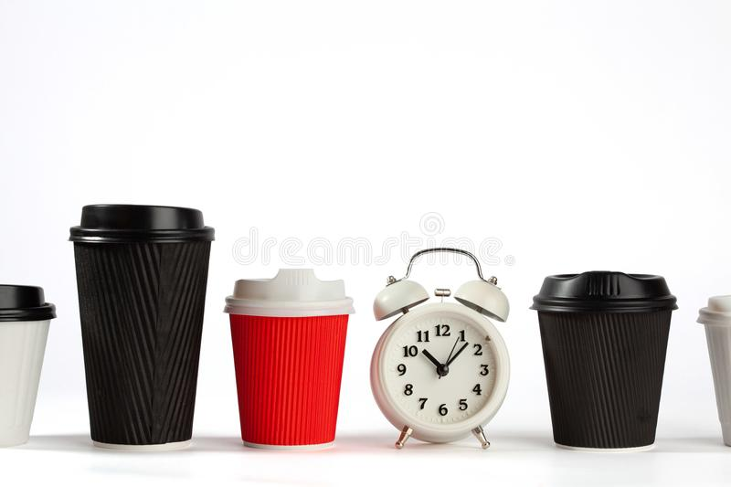 Time for coffee concept with retro alarm clock. stock photo
