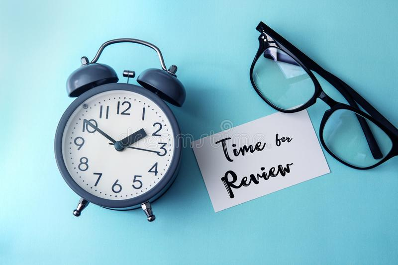 Time concept with paper note of Time fo Review message , alarm stock image