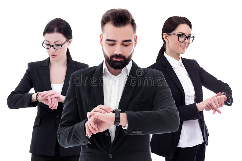 Time concept - portrait of young business people checking time on wrist watches isolated on white royalty free stock photography