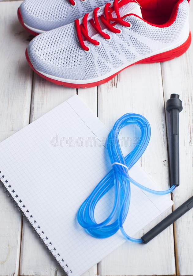 Time for diet slimming weight loss concept. Sport fitness on white wooden background. Time for diet slimming weight loss concept. Sport fitness, sneakers on royalty free stock photography