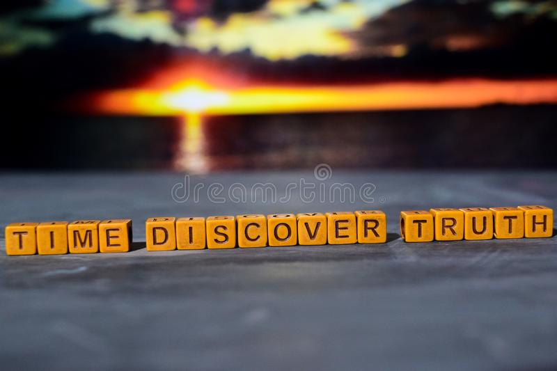 Time discovery truth on wooden blocks. Cross processed image with bokeh background royalty free stock photos