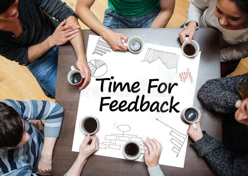 Time for feedback written on a poster with drawings of charts. During a brainstorm stock photo