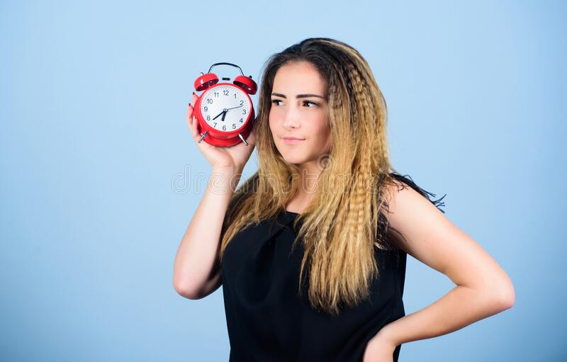 It is time. Few minutes. Time management. Punctuality and discipline. Woman hold red alarm clock. Counting time till royalty free stock photo
