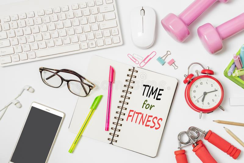 Time for Fitness active healthy lifestyle background concept. Flat lay of office workspace desk with keyboard and mouse, office royalty free stock photo