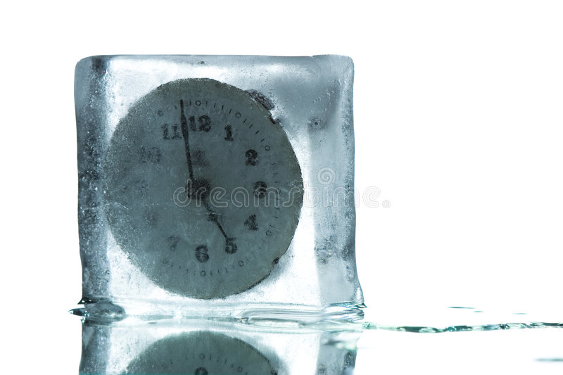 Time freeze. A concept image with a clock frozen just two minutes before 5 stock photo