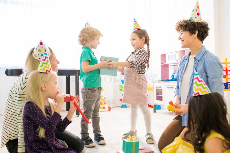 Time for gifts at birthday party royalty free stock photo