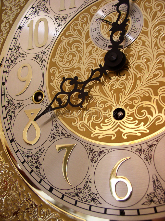 Time on a grandfather clock stock photography