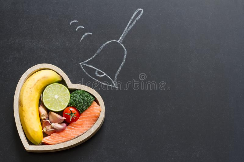Time for health heart abstract diet food concept on blackboard with bell stock photography