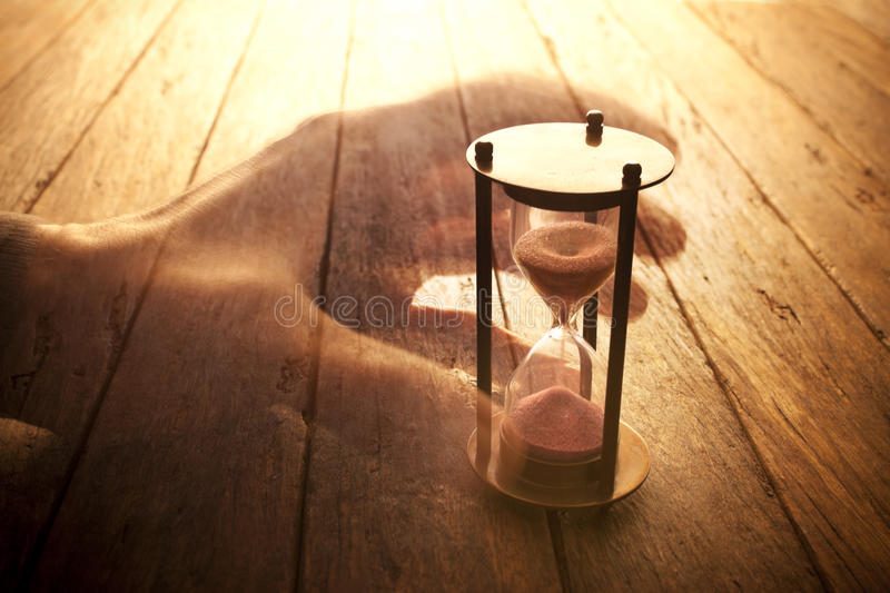 Time Hourglass Life Lifetime Insurance. An image that explores the aspects of time with a hand and hourglass stock images