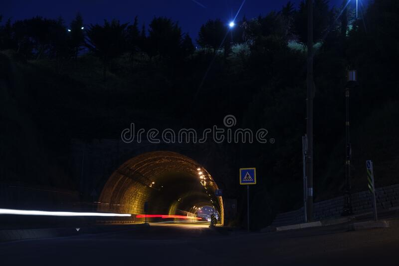 Time Laps Photography of Car Tunnel With Trees during Night Time royalty free stock photo