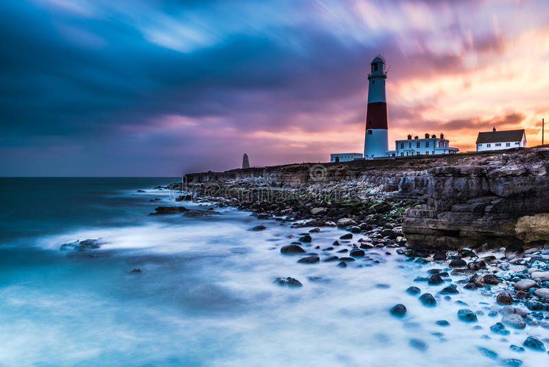 Time lapse of dramatic sunset and Portland Bill lighthouse stock photos