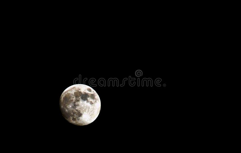 New Full July Moon Rising on a black background stock photos