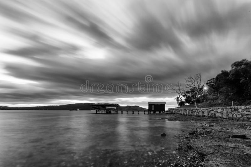 Time Lapse Photo of a House Near Body of Water in Grayscale stock photography