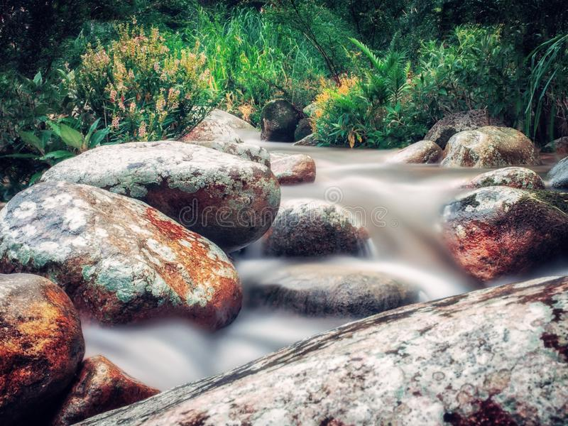 Time Lapse Photo of River Flowing on Rocks stock image