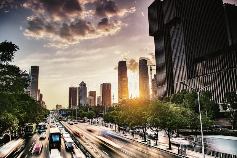Time Lapse Photo of Vehicles on Street Near Building at Sunset royalty free stock photo
