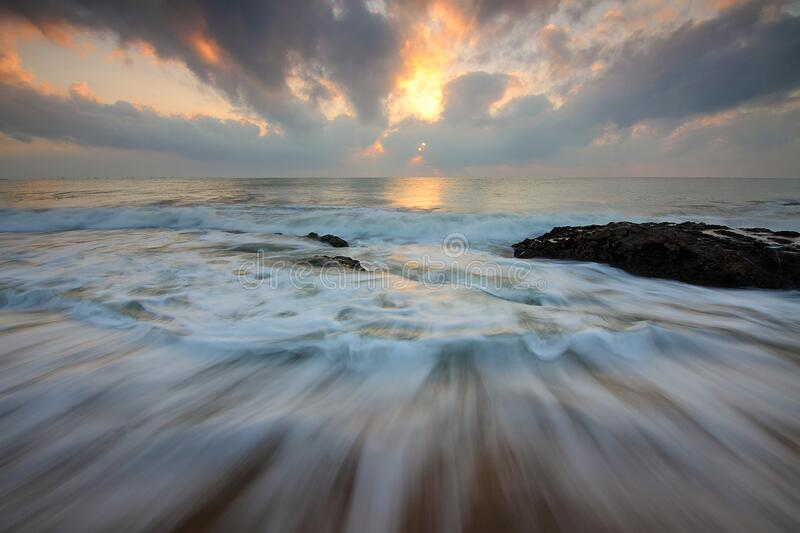 Time Lapse Photo of Water Current and Brown Rock Under White and Yellow Cloudy Sky stock photography
